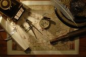 foto of treasure map  - nautical navigation tools on old map - JPG