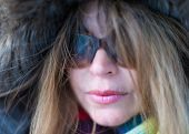 pic of close-up middle-aged woman  - Beautiful middle age woman close up portrait wearing a thick coat in the Canadian Winter - JPG