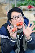 pic of overcoats  - Asian handsome tourist man wearing overcoat in strawberry greenhouse harvest fresh red