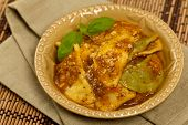 picture of shredded cheese  - Cheese and spinach stuffed ravioli pasta with tomato sauce and parmesan cheese - JPG