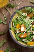 picture of mandarin orange  - Closeup of a plate of arugula salad with mandarins oranges beans sprouts and sliced almonds served with mandarin vinaigrette for healthy lunch - JPG