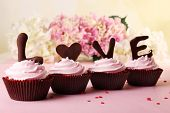 pic of cupcakes  - Delicious Valentine Day cupcakes on light background - JPG