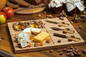 stock photo of brie cheese  - Cheese plate with cheese Dor blue - JPG