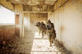 image of battlefield  - Soldiers stormed the building occupied by the enemy - JPG