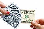 picture of cheater  - Pulling out 100 dollars isolated on white background - JPG