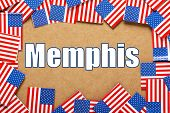 image of memphis tennessee  - Miniature flags of the United States of America form a border on brown card around the name of the city of Memphis - JPG