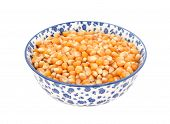 pic of maize  - Popcorn maize in a blue and white porcelain bowl with a floral design isolated on a white background - JPG