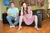 pic of disrespect  - Disrespectful man sitting next to angry pregnant woman - JPG
