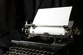 picture of short-story  - Old type writer with a blank sheet of paper - JPG