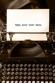 foto of short-story  - Old type writer with a blank sheet of paper - JPG