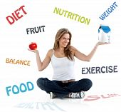 stock photo of healthy food  - Beautiful woman smiling with diet and nutrition words on the background - JPG