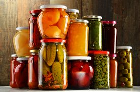stock photo of jar jelly  - Jars with pickled vegetables fruity compotes and jams in cellar - JPG