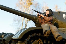 stock photo of panzer  - Portrait of young boy sitting on panzer - JPG