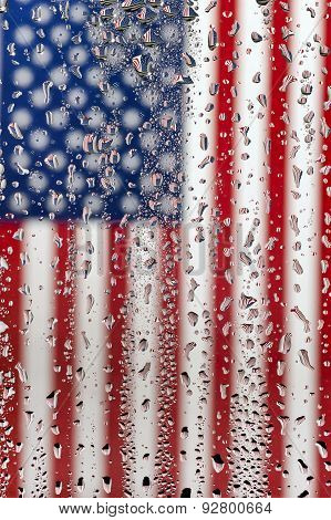 Hanging American Flag Under Glass With Water Droplets