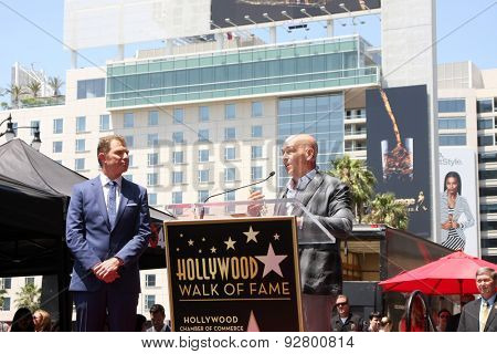LOS ANGELES - JUN 2:  Bobby Flay, Michael Symon at the Bobby Flay Hollywood Walk of Fame Ceremony at the Hollywood Blvd on June 2, 2015 in Los Angeles, CA