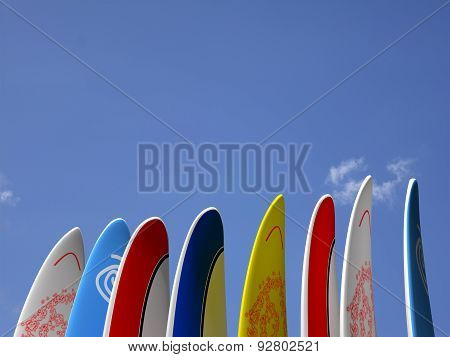 Surfboards with sky behind