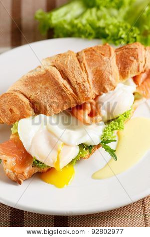 Poached egg with red fish