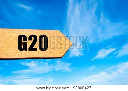 Blank Wooden Arrow Over Clear Blue Sky With Copy Space