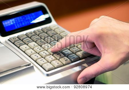 Person Entering A Sale On A Cash Register