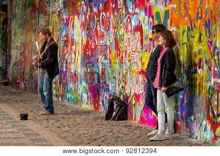 Prague Street Busker Performing Beatles Songs At John Lennon Wall