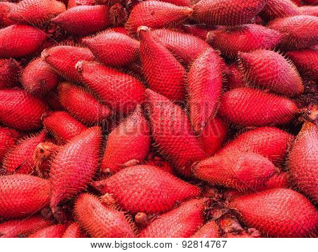 Red tropical fruit Salacca or zalacca.There are both sweet taste and sour.