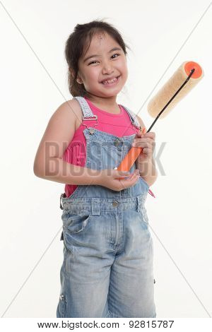 Little Asian child with painting roll on isolated back ground