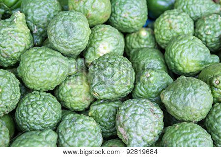 Heap Of Kaffir Limes On Market