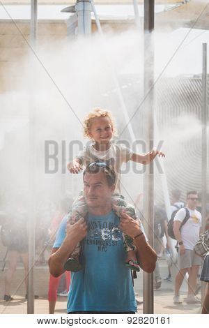 People Enjoy Vaporized Water At Expo 2015 In Milan, Italy