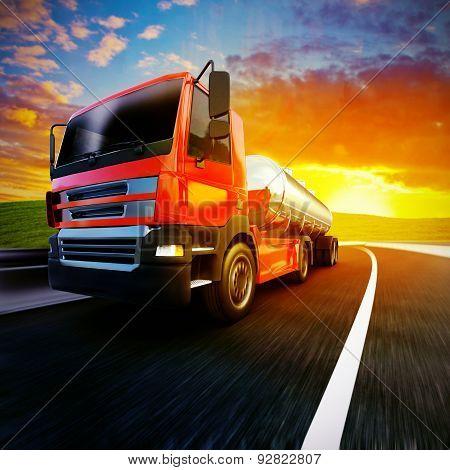 Red Semi Truck On Blurry Asphalt Road Under Evening Sky And Sunset Light