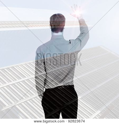 Rear view of businessman in shirt waving against low angle view of skyscrapers