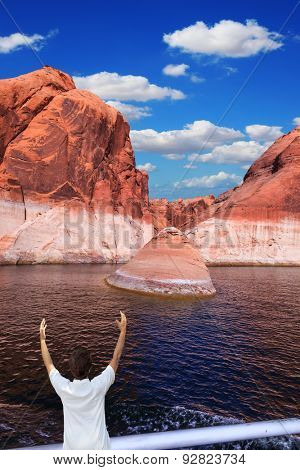 The elderly woman in white aft boats is delighted with the nature. The artificial lake Powell on the river Colorado, USA