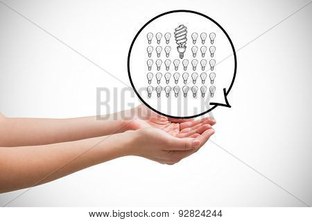 Hands presenting against white background with vignette