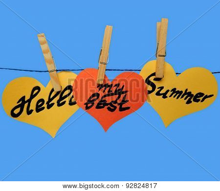 Yellow and orange  paper hearts on clothespins with inscription - Hello my best summer
