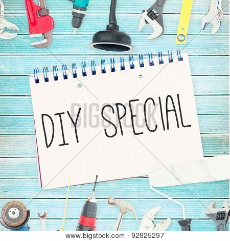 The word diy special against tools and notepad on wooden background