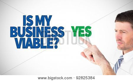 Businessman pointing with his finger against white background with vignette