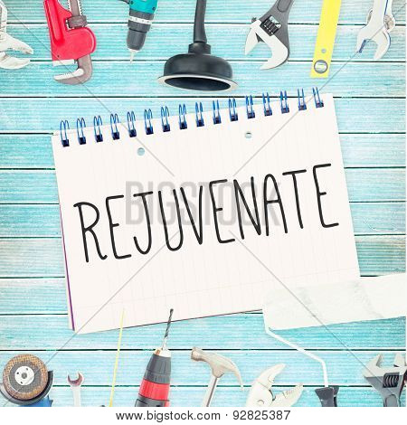 The word rejuvenate against tools and notepad on wooden background