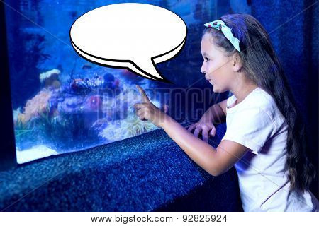 Speech bubble against cute girl looking at fish tank