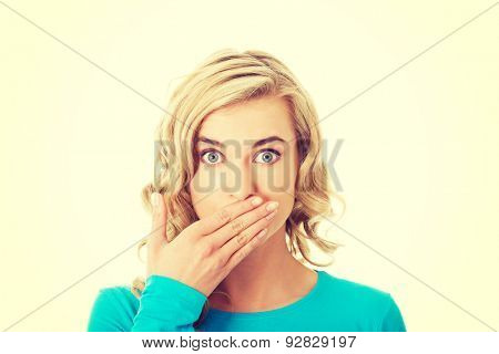 Portrait of a woman covering her mouth.