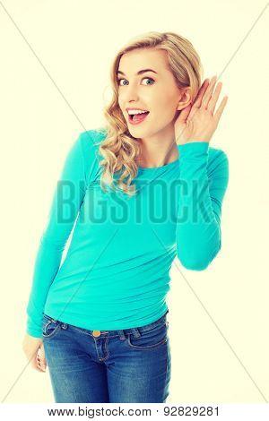 Full length woman overhearing a conversation.