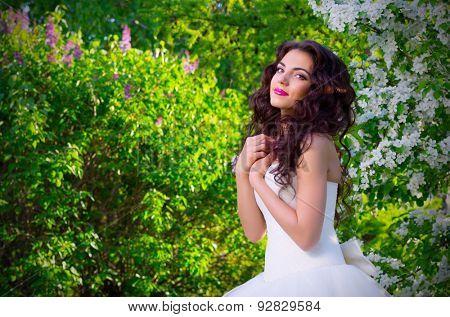 Bride in blooming apple trees