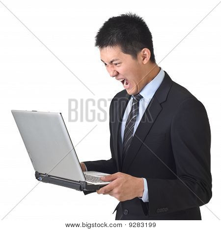 Angry Business Man Holding Laptop