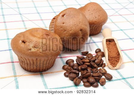 Fresh Baked Muffins, Coffee Grains And Powdery Cinnamon
