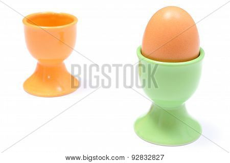 Closeup Of Boiled Egg In Green Cup. White Background