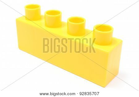 Yellow Building Block On White Background