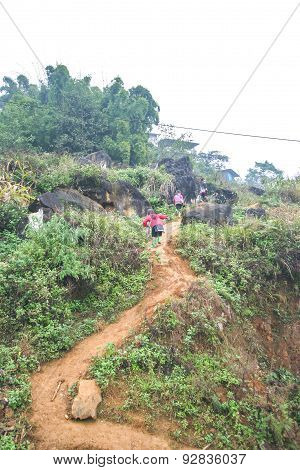 Two Sapa Children In Vietnam Walking Up Hill Follow Their Mom