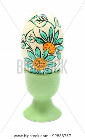Colorful Easter Egg In Green Cup. Isolated On White Background