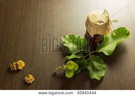 Jar Jam Nuts On Wooden Background