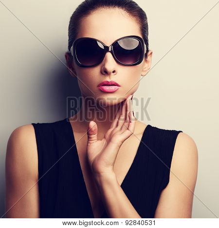 Sexy Glamour Female Model In Trendy Sun Glasses With Hand At Face. Closeup Vintage