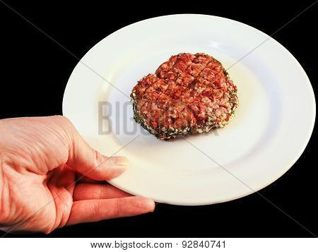 Serving Raw Burger On White Plate Isolated On Black