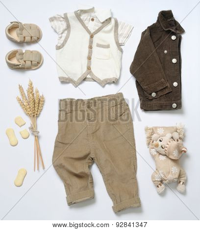 Top View Fashion Trendy Look Of Baby Boy Clothes With Toy And Cookies